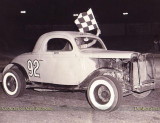 1955 - Otis Bodiford with the checkered flag in Old 92 in the early days at Hialeah Speedway