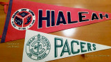 Pennants for the Palm Springs Junor High Pacers and Hialeah High Thoroughbreds