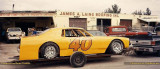 1990 - Ricky Gosney's #40 car ready to go in front of Jimmy Laing's and Dee Powell's shops that are in the background