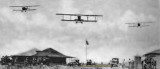 1918 - three U. S. Marine Corps aircraft flying over aviators and support staff at Marine Flying Field Miami