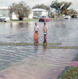 Early 1960's - two young boys playing on a flooded Hialeah street