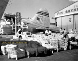 Late 1940s - Pan American C-46F Curtiss Wright Commando N74172 being loaded at Pan Am hangar 5, Miami