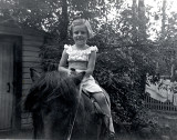 Riding a pony at the cottage, 5 years old