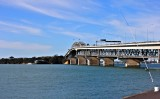 The 1,020 m (3,348 ft) long bridge is an eight-lane box truss motorway bridge over the Waitemata Harbour, Auckland City with the North Shore.