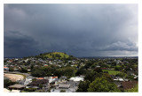 Looking west here. The Auckland Harbour Bridge is behind Mt Victoria, the 2nd of Devonport's extinct (we hope) volcanoes. It never actually rained on the North Shore until 11.30pm