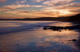 Carne Beach in Cornwall at dusk