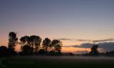Mist at sunset over the fields near Hele in Devon