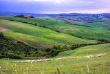 Tuscan villas, rolling green hills and grazing sheep