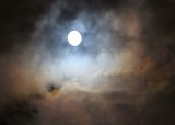 christmas full moon lights up a stormy sky