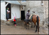 A family man preparing the horses