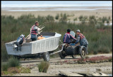 Fishermen towing their boat down to Caspian Sea the easy way - with a motorbike!