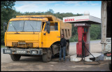 A common sight - old Russian truck at a petrol station