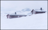 Small norwegian hytter in storm