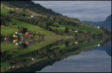 Small village Olden mirroring in the ocean - Norway