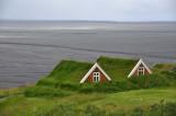 Original turf houses, volcanic plain behind