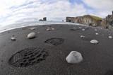 Foostep on black sand