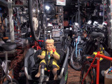 View in a bicycle shop on a Saturday evening