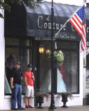 Chris and Gage, hanging out in front of a dress store on a Sunday .