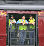 N&W 611 crew members enjoy the ride from the tool car