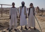 Three camel handlers