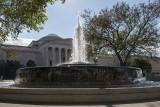 Two buildings through a fountain (1)