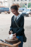 Young woman dicing coconuts in the Pakse market