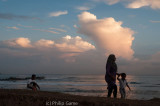 Local family strolling at sunset, Galle