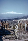 Mt Etna beyond the Roman ruins at Taormina, Sicity