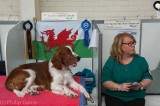 Dog show exhibitor with her prize winner