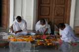 Women preparing garlands at the Shri Govindajee Mandir (temple)