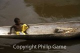 Boy in a dugout canoe