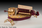 The Rose a Modern Hurdy Gurdy with covers removed and opened to see inner workings.
