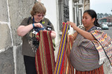 Lynda juggling everything while buying that beautiful table runner!  Only $10.00 by the way.....