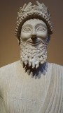 Limestone votary of a bearded male with a wreath
