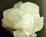 Calcite prism and rhomb crystals to 4 cm in 6 cm group. Cambokeels Mine, Co Durham, UK.