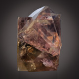 Fluorite twin, 65 mm, hexoctahedral and shallow tetrahexahedral faces are seen. Boltsburn Mine, Weardale, Co Durham.