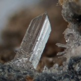 Anglesite, Dene Quarry, Cromford, Derbyshire. The crystal is about 2.5 mm long.