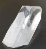 Two transparent lustrous calcite crystals, 39 mm long, in parallel growth. Antique German label states Kalkspat, Egremont.