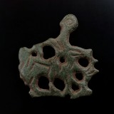 Horse and rider dagger chape in copper alloy, 32 x 30 mm, late Saxon/early Norman, 11th century. Found in Norfolk, UK.
