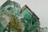 Detail of Middlehope Shield (Old Vein) green fluorite showing thin purple phantoms in a crystal 22 mm on edge.