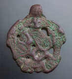Gripping beast pendant, Borre styles, 34 mm, 10th century, Ukraine, copper alloy with gilding.