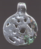 Jellinge-style backward-looking animal billon pendant with barred body, 36 m, copper silver (billon) alloy. Gnyozdovo-Smolensk.