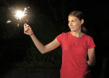 GRANDDAUGHTER MIRI'S FRIEND, SARAH, GETTING A HEAD START ON THIS YEAR'S 4th OF JULY CELEBRATION  -  ISO 6400