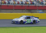 ABOUT TO ENTER TURN 1  -  ALMOST A BLUR AT 175 mph!  -  TAKEN WITH A SONY 18-200mm E-MOUNT LENS