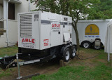 ONE OF THE TWO POWERFUL GENERATORS POWERING MUCH OF THE ON-SITE EQUIPMENT
