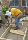 BUILDING A FRAME FOR THE DECK STEPS  -  THE COMPLETED RAMP MAY BE SEEN IN THE BACKGROUND