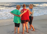 TWO OF OUR LADIES, PRAYING WITH A WOMAN THEY MET ON THE BEACH