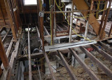 OUR ASSIGNMENT WAS TO SHORE UP SOME SAGGING ROOF SUPPORT AREAS AND STRENGTHEN CRITICAL FLOOR JOISTS