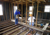 OUR FATHER AND SON TEAM MEMBERS, WORKING HARD TO STRENGTHEN THE FLOOR JOISTS