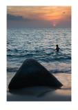 Joseph in the ocean, sundown, Phuket